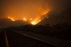 Ventura, CALIFORNIA, USA - DECEMBER 6: Thomas Fire burning near Highway 101, spreading towards houses by the ocean near Highway 1 on December 6, 2017 in Ventura, California, United States. (Photo - Yichuan Cao/Sipa USA)