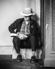 Quietly reading at the Ferry Building, San Francisco