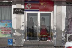 North Korean waitresses wait inside the gate of a restaurant owned by North Korean government in an effort to attract customers in Dandong, Liaoning Province, China on October 30, 2018. (Photo by Yichuan Cao/Sipa USA)