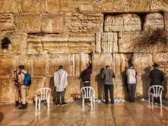 People in prayer at the Western Wall