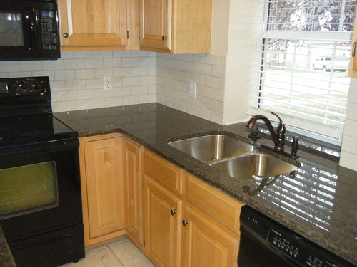 Tropic Brown Granite Counter top with Tile Backsplash