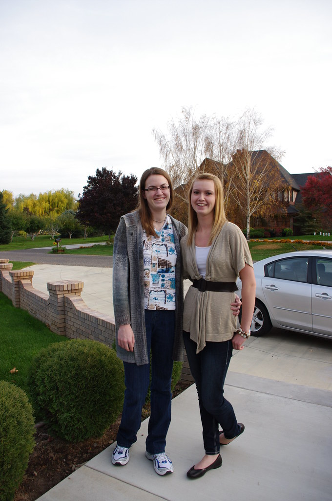 Sisters Standing near driveway