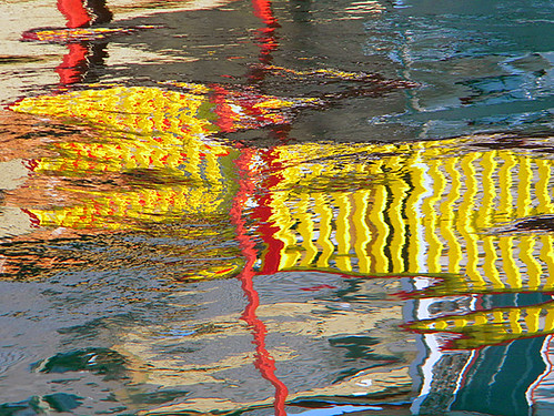 reflection of yellow fence on the water