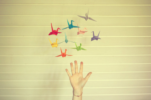 reaching for origami cranes