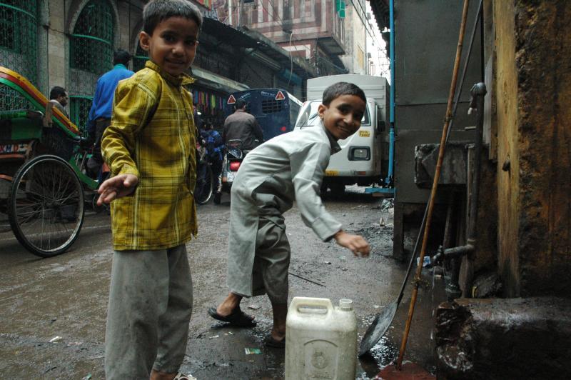 children and water, Turkman gate, Delhi, India
