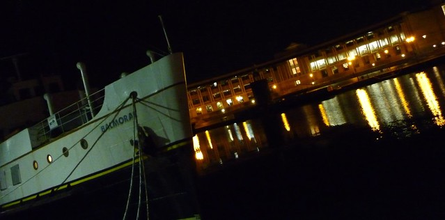 A picture at night across a quayside in Bristol with a boat and pretty lights