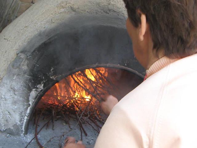 Firing up wood oven for flaounes