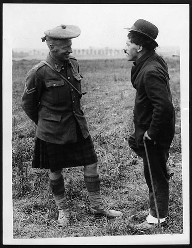 Charlie Chaplin talking to a Scot