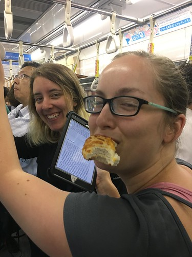 Sneaking a bite on a Tokyo train