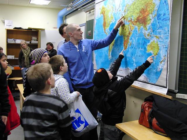 Pál showing kids in Sørvágur where he's been