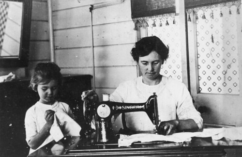 Violet Trundle sewing with a Singer sewing machine at her home in Hughenden, ca. 1925