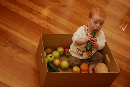 Eva enjoying the fruit and vegetable delivery