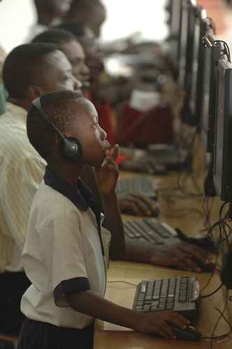 People work on computers at the Busy Internet computer center in Accra