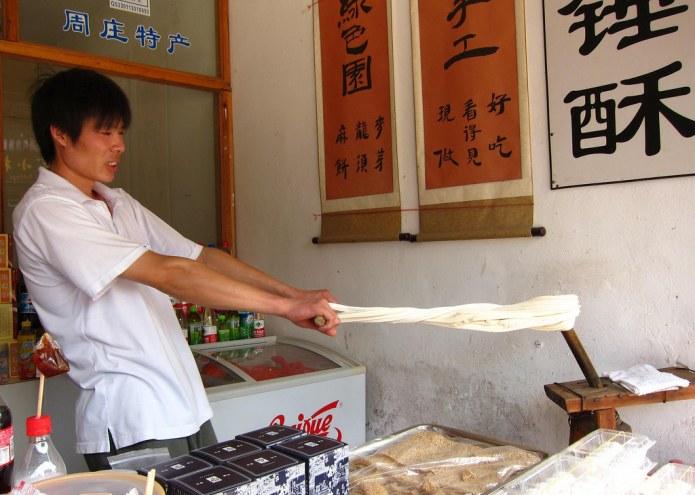 man making barley sugar