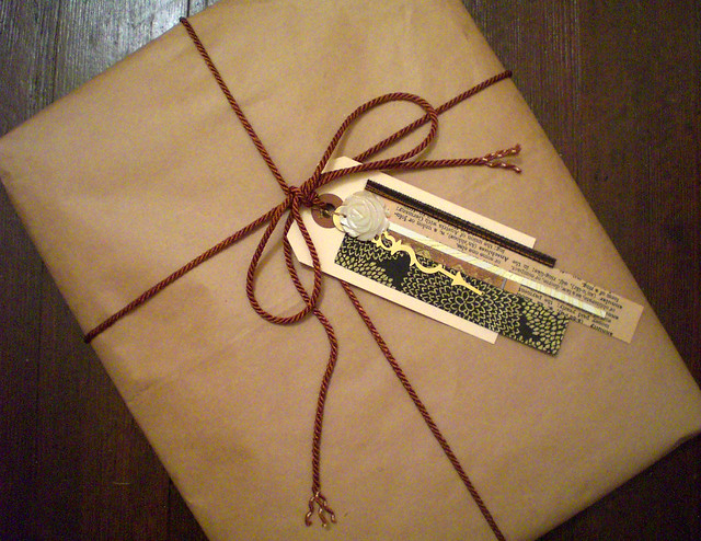Image of a brown paper package tied up with string