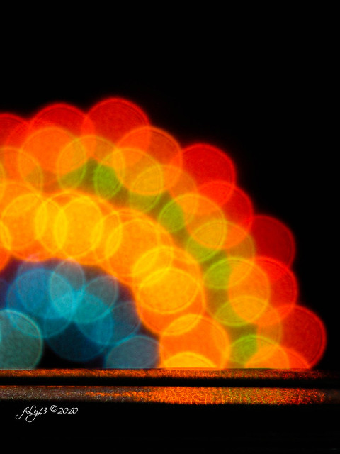 bokeh blurred christmas light rainbow