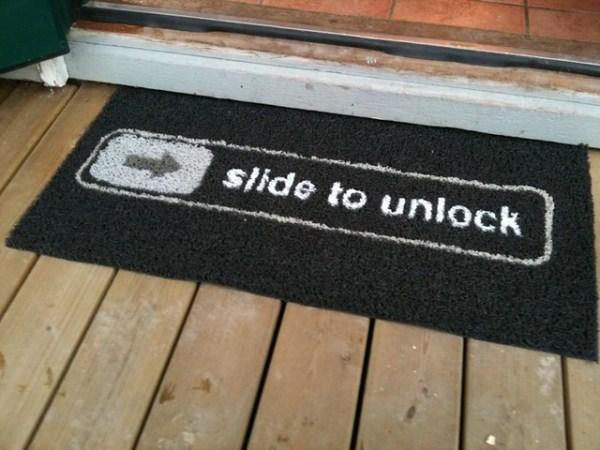 """""""Slide to unlock"""" doormat"""