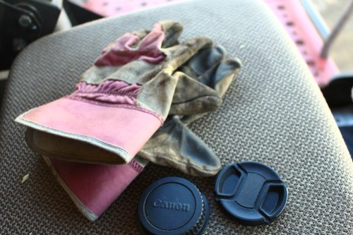 A bloggers necessities -- gloves and lens caps.