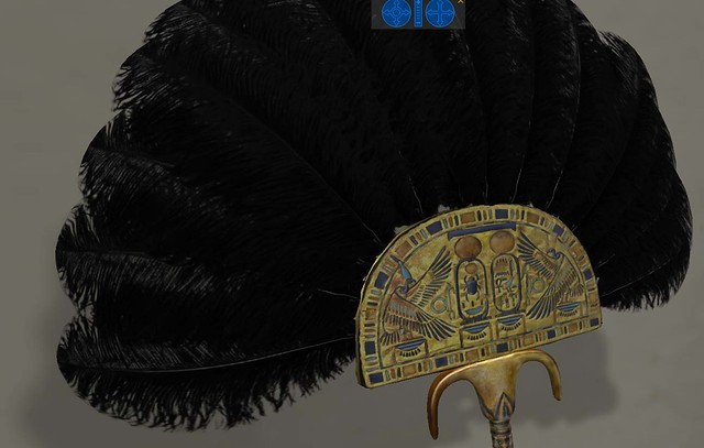 A beautifully detailed ostrich feather fan in the pharaoh