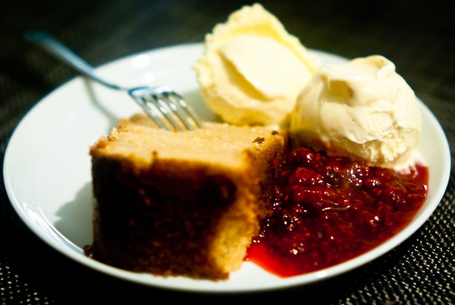 Lemon cake, vanilla ice cream and raspberry sauce