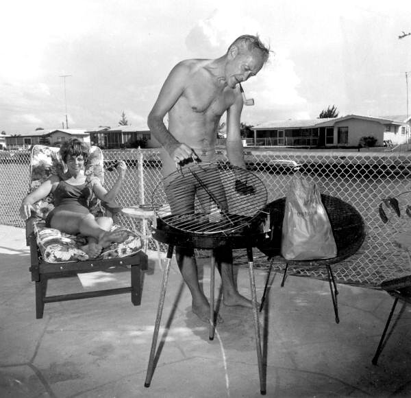 Couple outside with their grill: Cocoa Beach, Florida