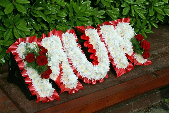 mum wreath red roses white flowers