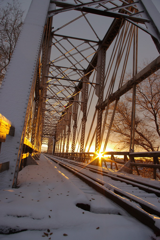 Sunset. Wintertime. Trainbridge