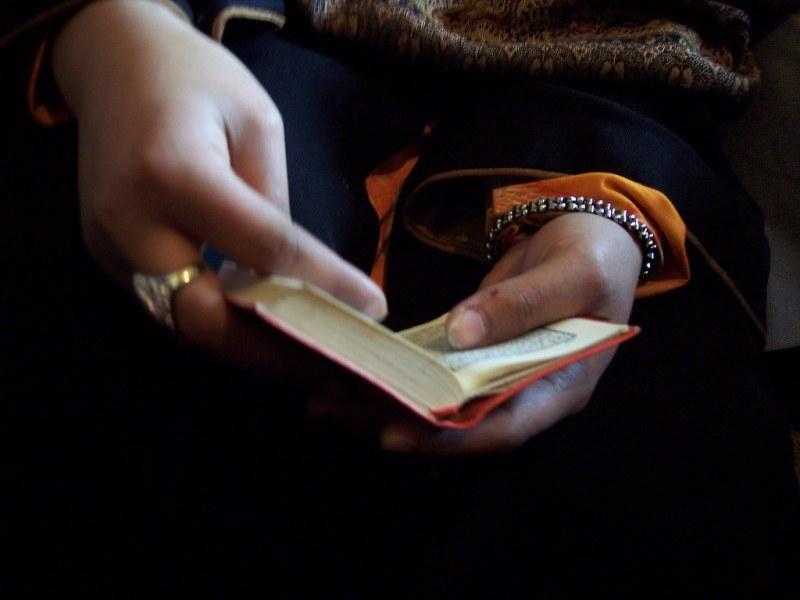 Girl Holding Koran in Kabul, March 2006
