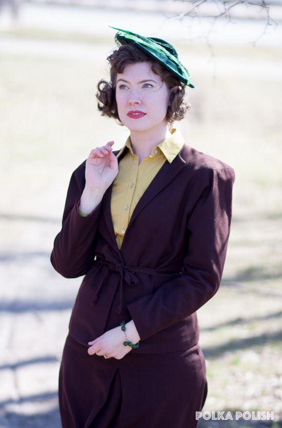 1940s green wool tilt hat with feathers paired with a chocolate brown suit and chartreuse blouse