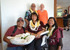 Luana Dang (center) poses for a photo with her family members and Hawaii CC Chancellor Rachel Solemsaas (right).
