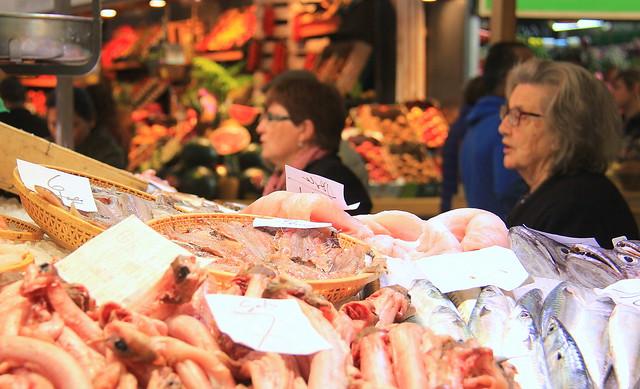 Locals buying fish at Girona Food Market