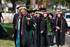Some of the 110 JD graduates of the UH School of Law crossing the street on their way to commencement at Andrews Amphitheater on Sunday, May 14. Photos by Spencer Kimura and Mike Orbito