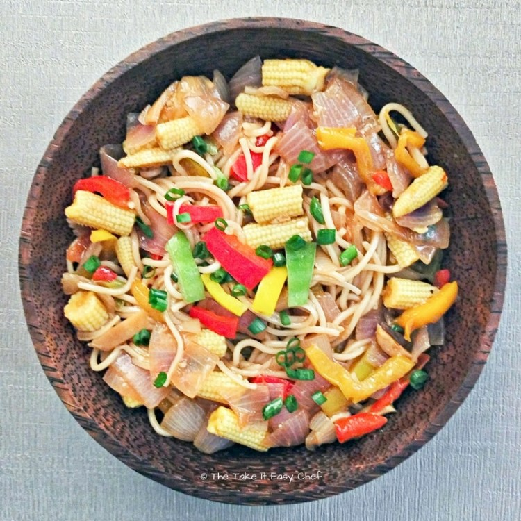 Baby corn noodles with capsicum and onions