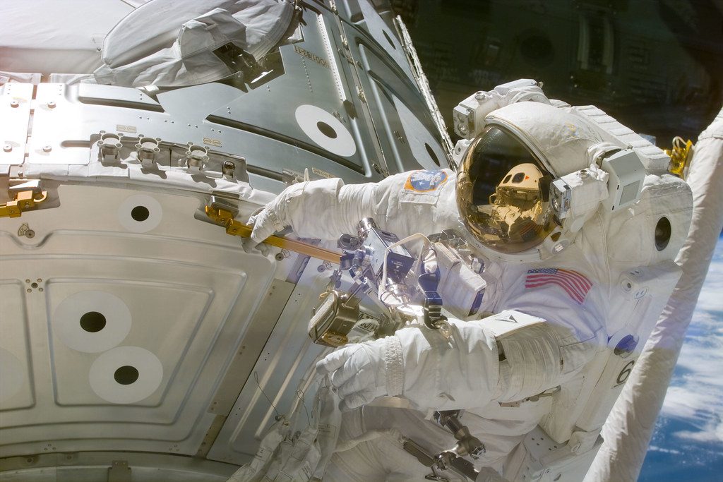 Astronaut Newman holds onto handrail 0133 on panel NOD1/C2-07