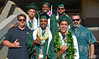 Football graduates (clockwise) RJ Hollis, Jeremy Castro, Isaiah Bernard, Makoa Camanse-Stevens, and Davasyia Hagger along with offensive coordinator Brian Smith (left) and head coach Nick Rolovich at UH Manoa's spring 2017 commencement ceremony at the Stan Sheriff Center on Saturday, May 13, 2017.