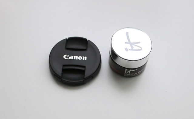 Bye Bye Redness next to my lens cap - the lens cap has a larger circumference
