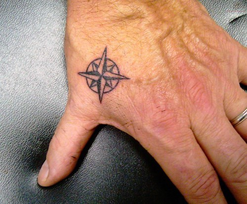 mens-nautical-star-awesome-simple-hand-tattoo-ideas