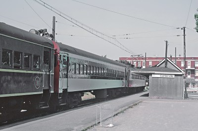 CN EMU suburban cars in both paint schemes at the Catrierville stop in Montreal, Que. on September 1, 1968