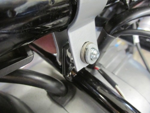 Lower Fairing Bracket Clamp Installed with Washers