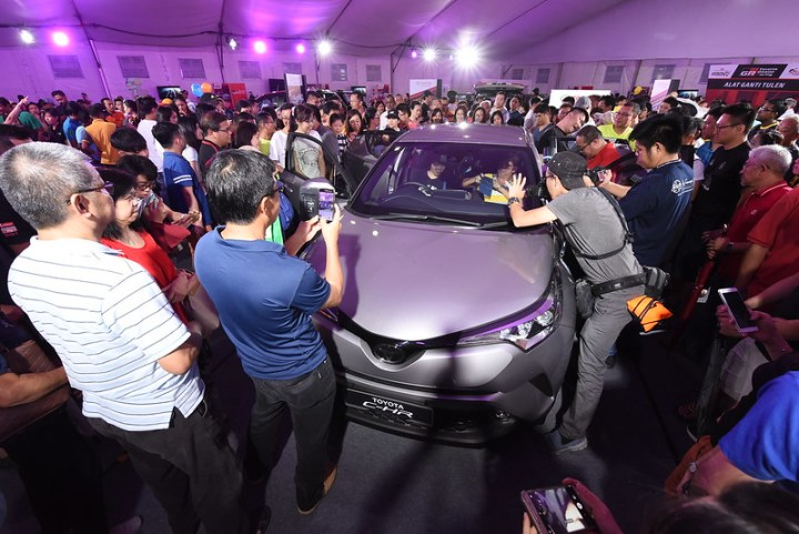 Crowding around the brand new CHR which made its debut in the Northern region