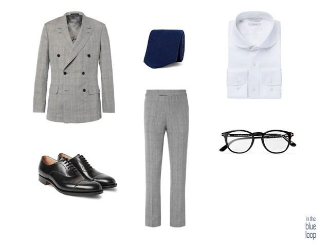Look masculino formal con traje de estampado príncipe de Gales, corbata azul, camisa blanca, zapatos oxford y gafas