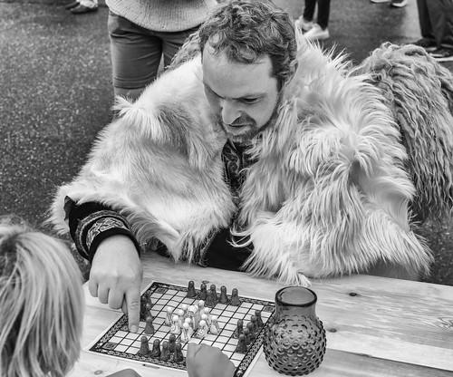 A Viking playing Hnefatafl