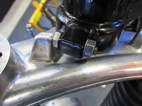 Steering Stop Limit Bolt Reduces Maximum Handlebar Movement To Accommodate Narrow RS Fairing