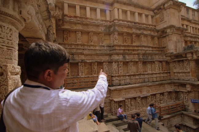 Mr. Guide at Rani Ki Vav..How they speak so fast? They just Go on and on...