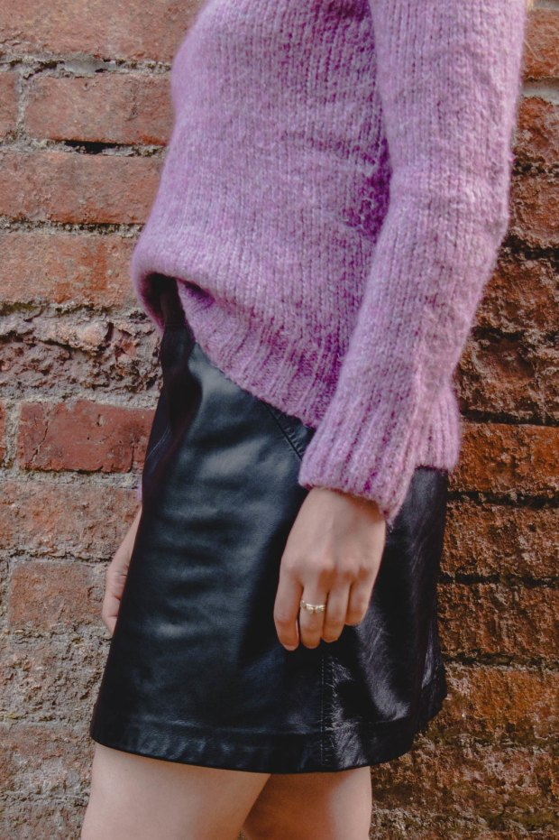 purple jumpers and black leather skirt