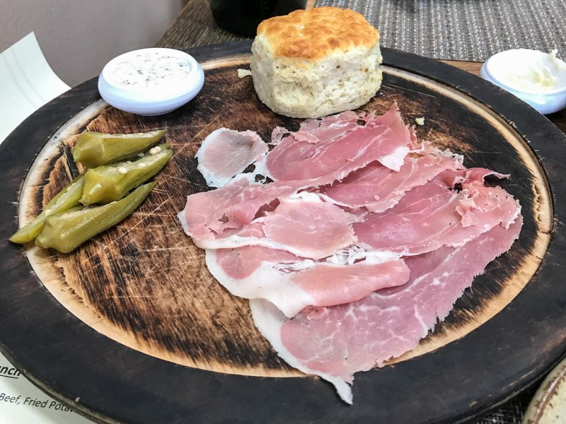 A Plate of 24-Month Bob Wood's Country Ham, Black Pepper Biscuit, Dijoinaise, Pickles ($15)
