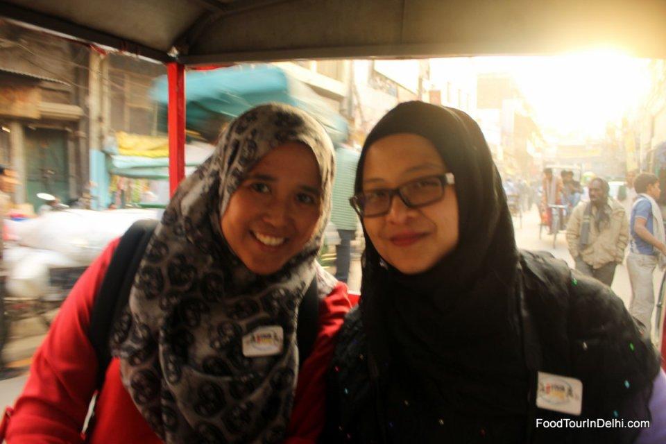 Riding electric rickshaw