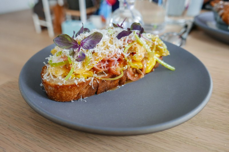 Squash Toast, acorn and delicata squash, pickled red onion, sunflower seed, parmesan, Opal basil, Calabrian chili ($9)