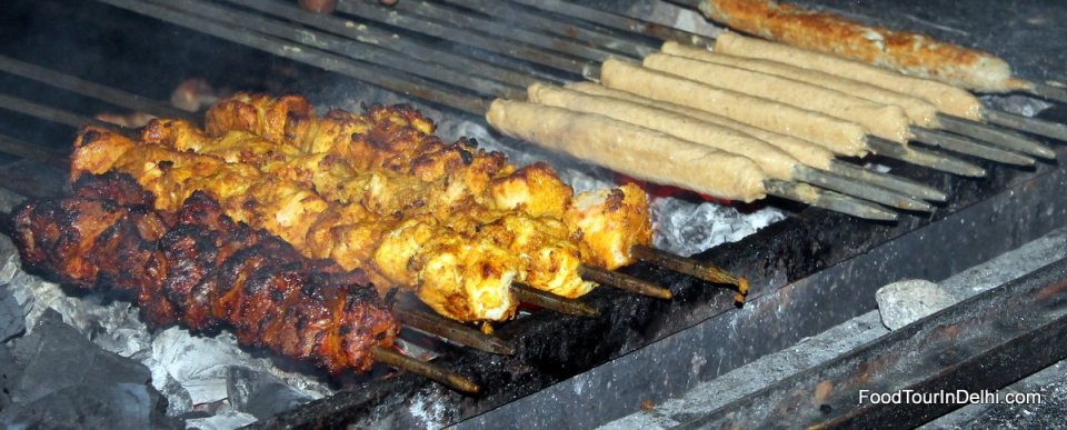 Tasting different types of freshly cooked kababs and tikkas