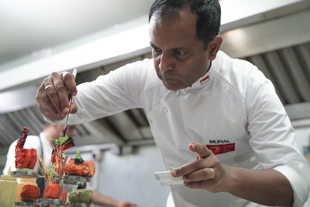 Song of India Head Chef, Manjunath Mural preparing dishes (1)